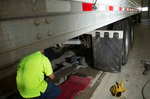 Man working on truck repair at MN 19 Truck Wash & Repair